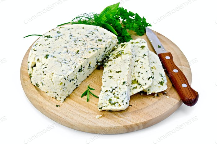 Cheese homemade with spices on a round board