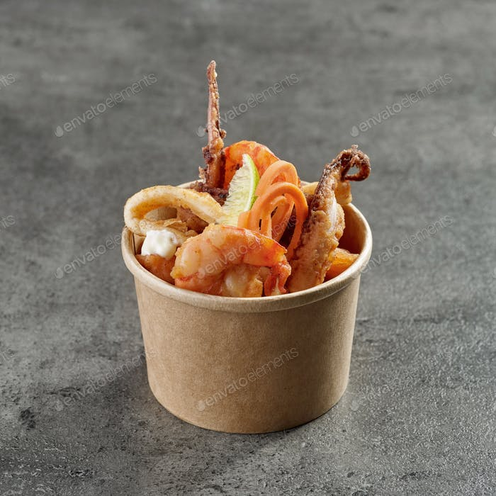 fried sea food snacks in paper box