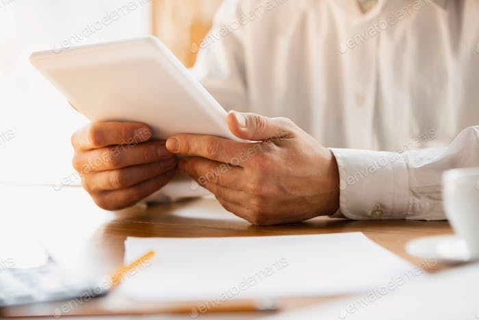 Close up of caucasian male hands, working in office, business, people