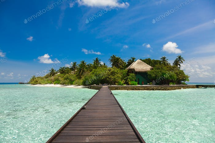 The path to the bungalow and island over the water