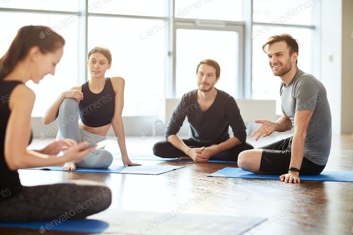 Talking to yoga teacher at class