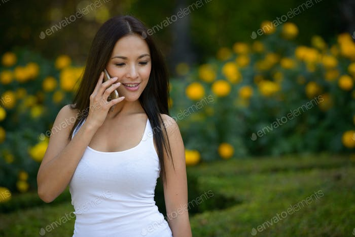 Portrait of beautiful Asian woman at the park outdoors