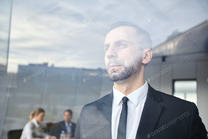 Serious man by window
