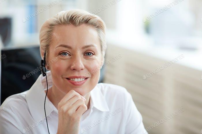 Smiling Businesswoman Wearing Headset