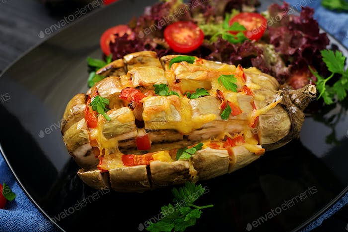 Eggplant baked with cheese and tomatoes.