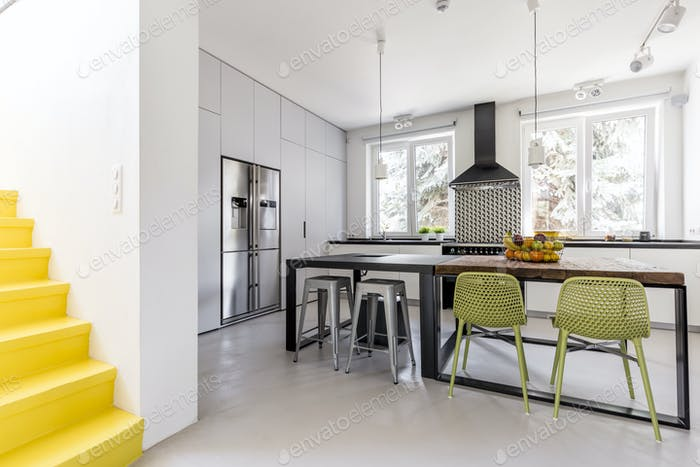 Minimalist kitchen seen from anteroom