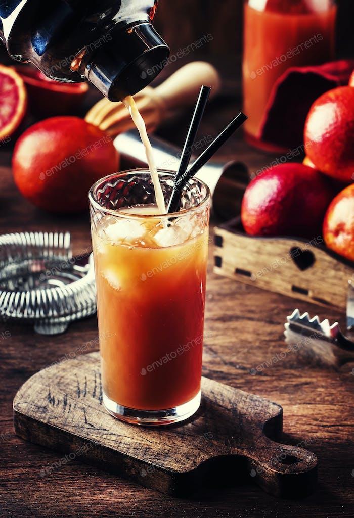 alcohol cocktail with vodka, orange juice, bloody orange
