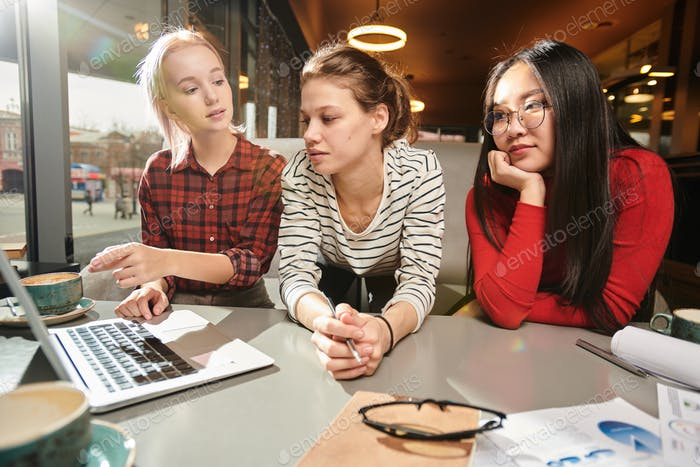 University students studying with computer