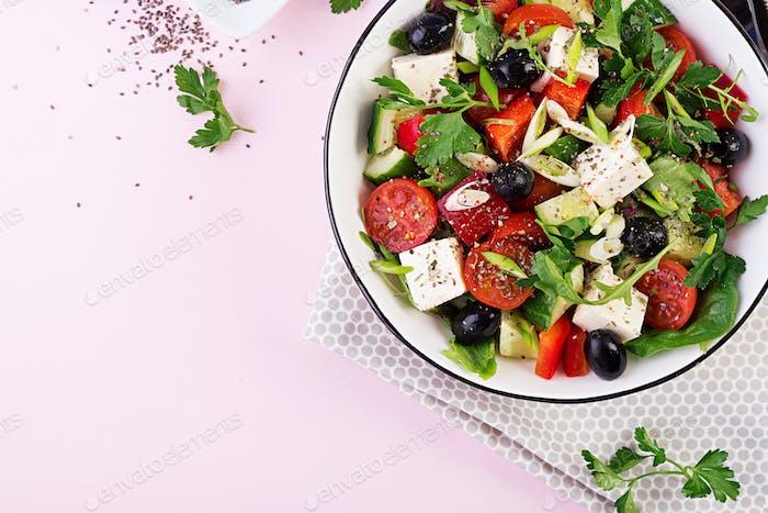 Greek salad  with cucumber, tomato, sweet pepper, lettuce, green onion, feta cheese