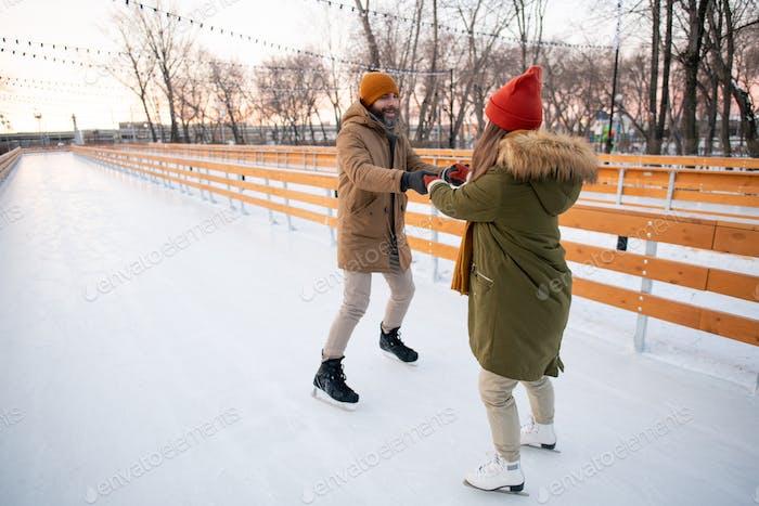 Couple having fun on the rink
