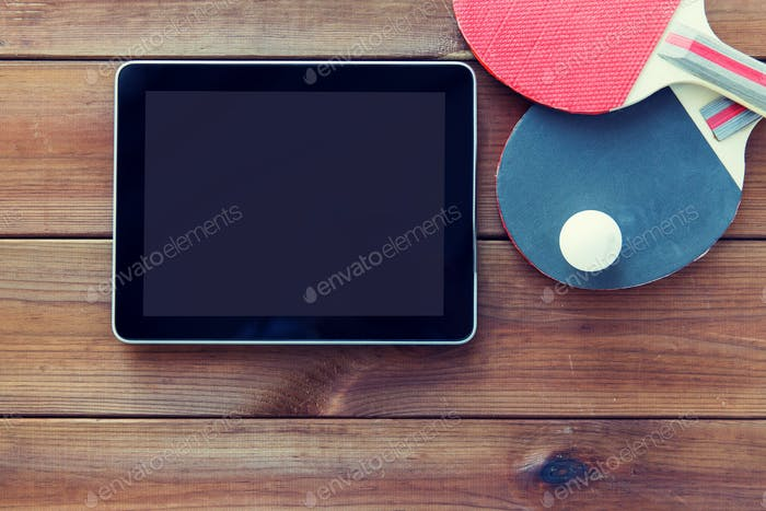 close up of table tennis rackets and tablet pc