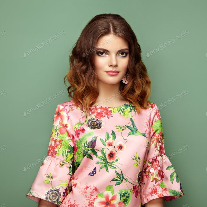 Brunette young woman in floral spring summer dress