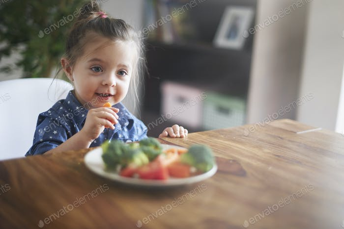 Lunch time! She's eating a healthy vegetables