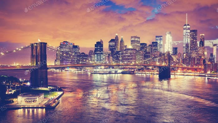 Color toned panoramic pictue of New York at night.