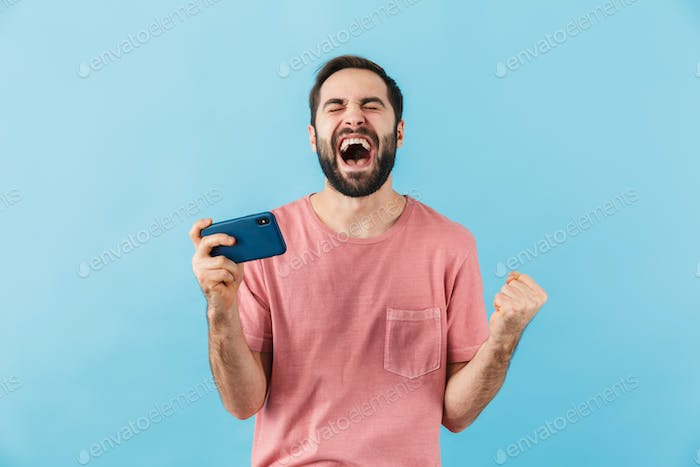 Happy man isolated over blue wall background