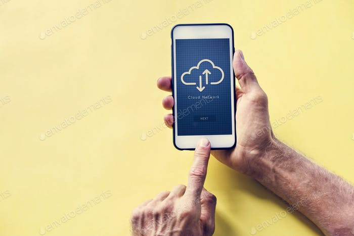 Hands holding a smartphone with cloud network on screen