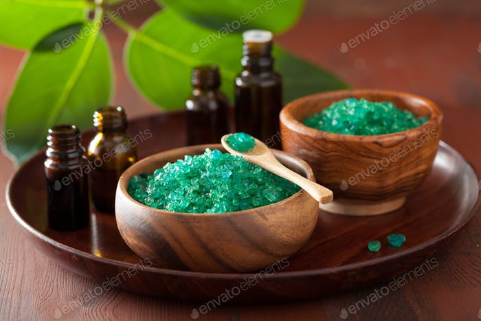 green herbal salt and essential oils for healthy spa bath