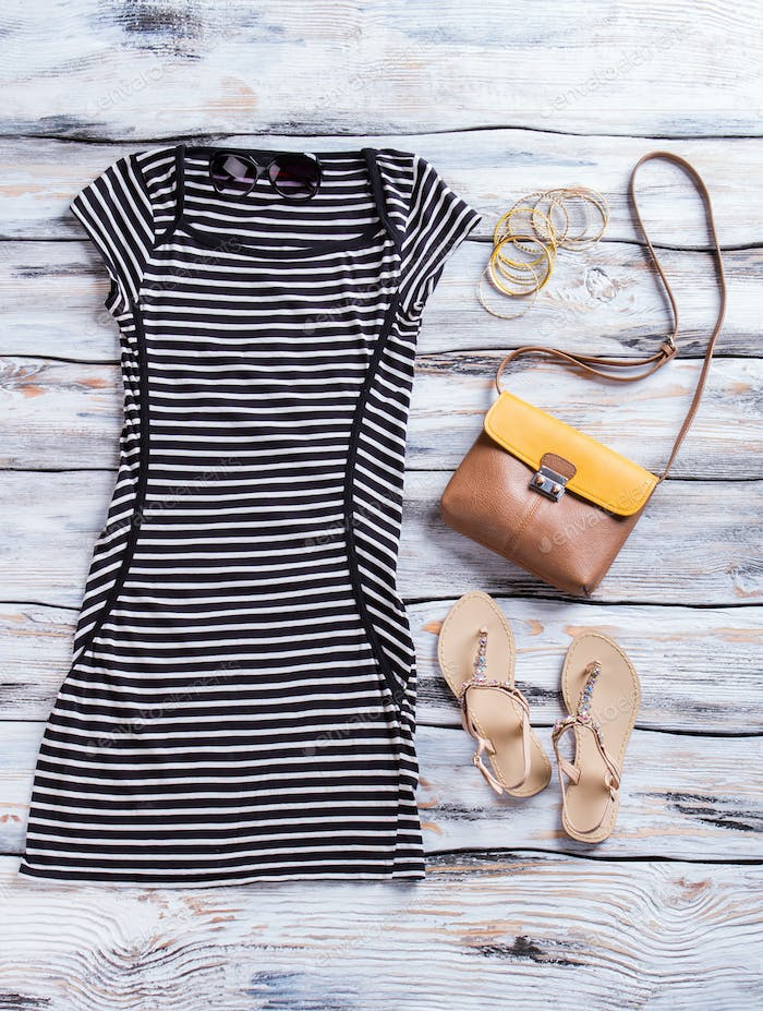 Striped dress with dark sunglasses.