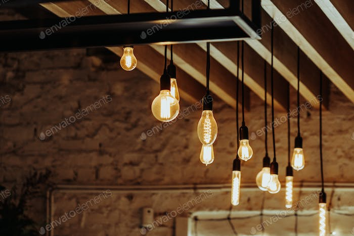 Vintage interior in a loft. Close-up of retro hanging bulbs.