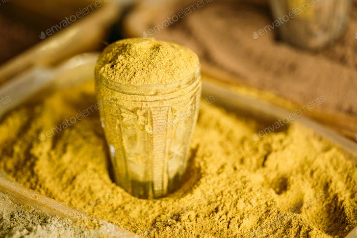 Close Of Turmeric Powder In Glass In Heap Of Bright Yellow Fragr