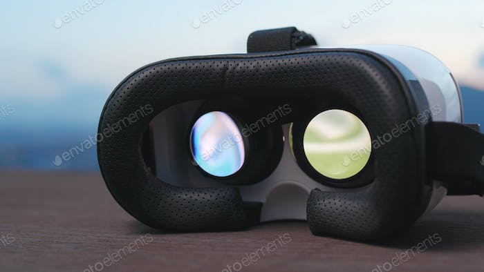 Virtual reality device playing game inside in the evening