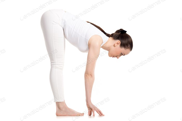 Yogi female standing in Uttanasana pose