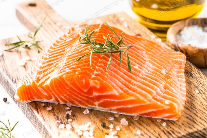 Fresh fish salmon with lemon sea salt and rosemary on white