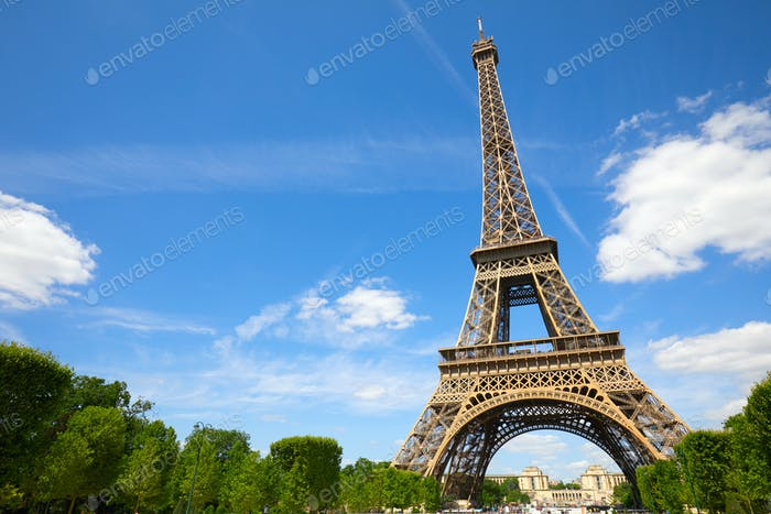Eiffel Tower in Paris in a sunny summer day, clear blue sky
