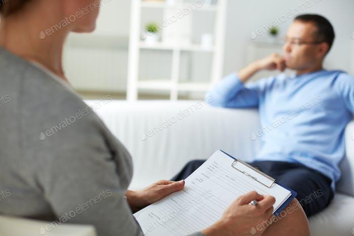 Man at psychologist