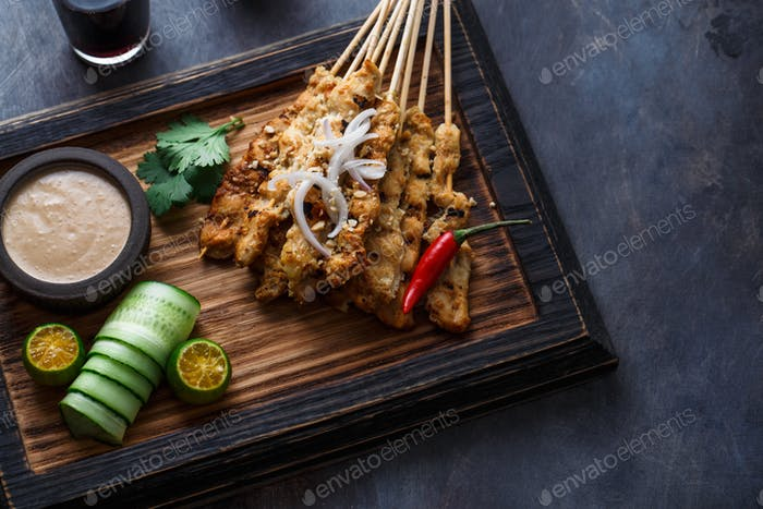 Sate Ayam - Malaysian famous food. Is a dish of seasoned grilled meat, served with sauce