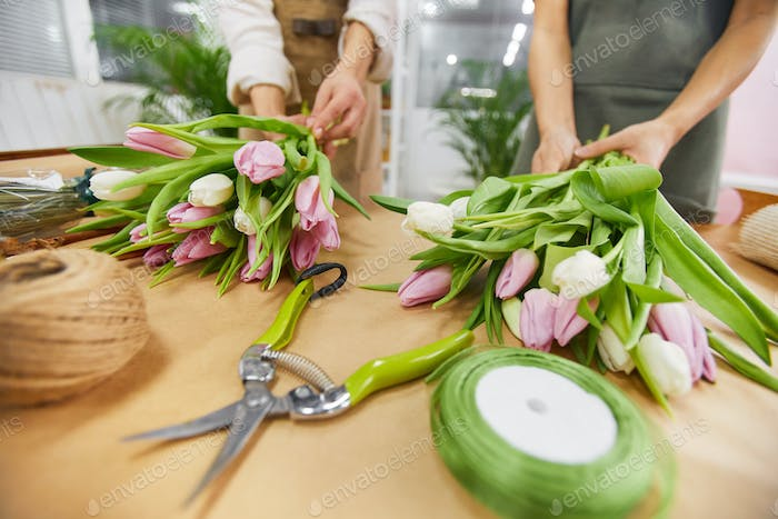 Florist Arranging Tulips in Flower Shop