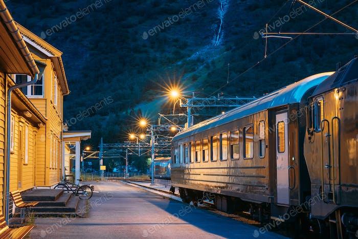 Flam, Norway. Famous Railroad Flamsbahn. Green Norwegian Train Near Railway Station