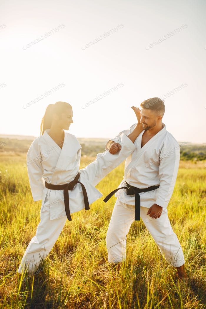 Female karate on training with male instructor