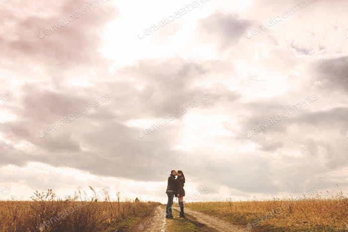Landscape portrait of young beautiful stylish couple sensual and