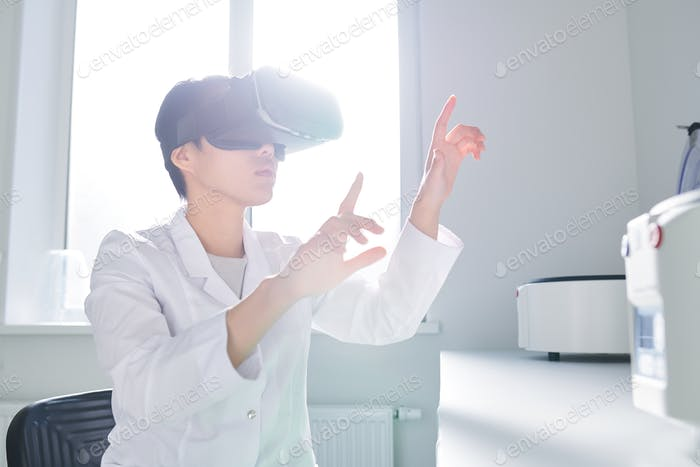 Asian innovation scientist using VR simulator