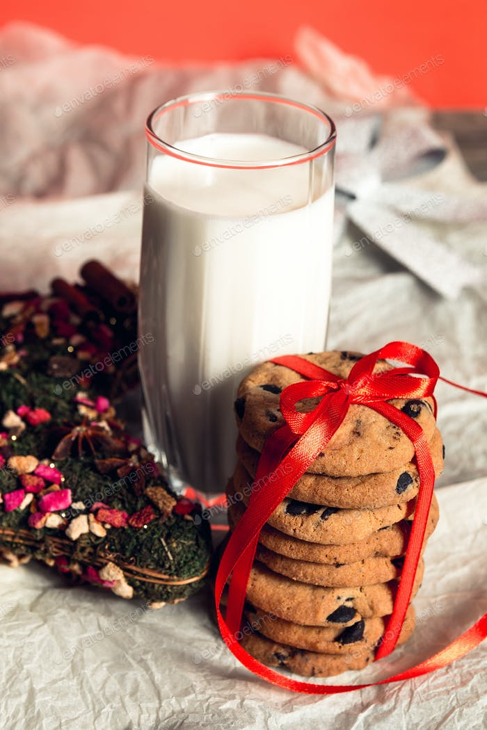 Milk and cookies on white background for Santa Claus. Christmas decoration. New year.