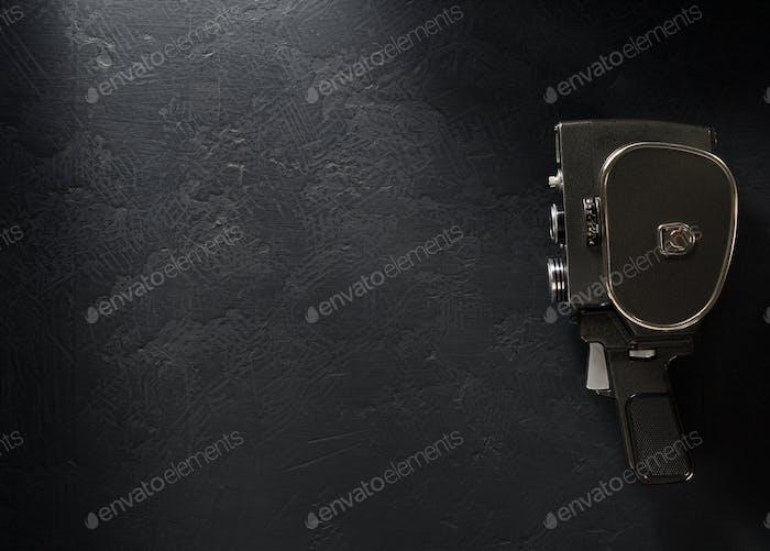 movie camera at black background