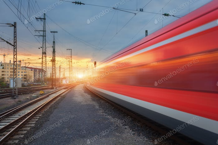 High speed red passenger train on railroad track