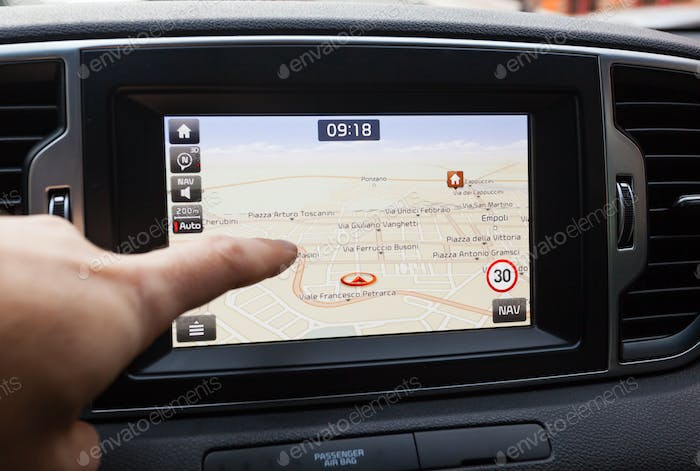 Navigation panel inside a car. Finger pointing on destination po