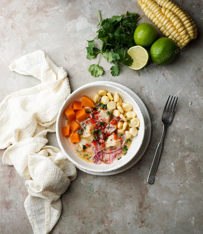 cebiche, ceviche,  latin america meal, with hand squeezing   lime juice , peruvian marinated fish
