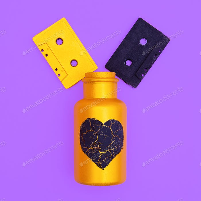Audio cassettes and art creative bottle. Minimal flat lay music concept