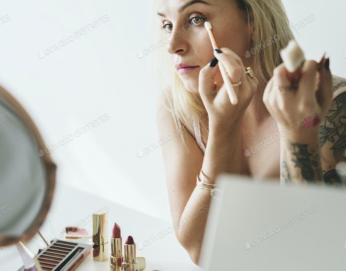 Beauty blogger doing makeup tutorial