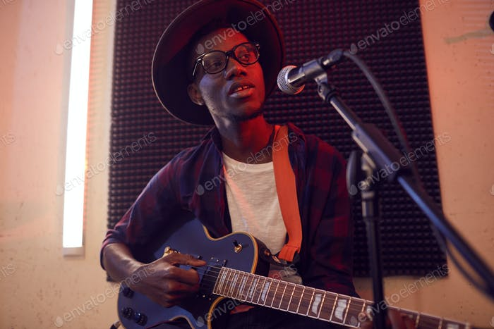 Young African Man Singing in Studio