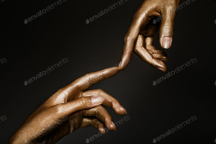 beautiful hands in golden paint