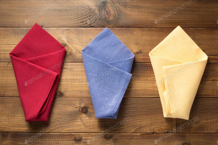 folded napkin on wooden background