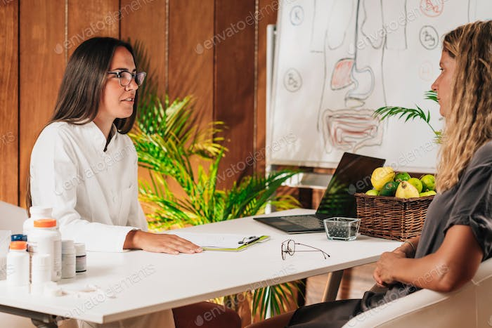 Nutritionist Advising a Client