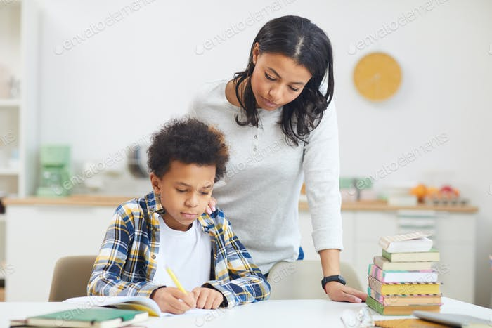 Mother Homeschooling Son