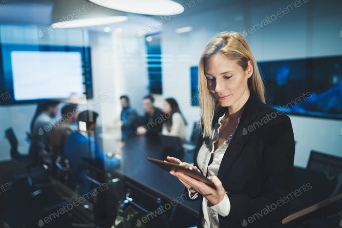 Business woman holding a tablet in conference room