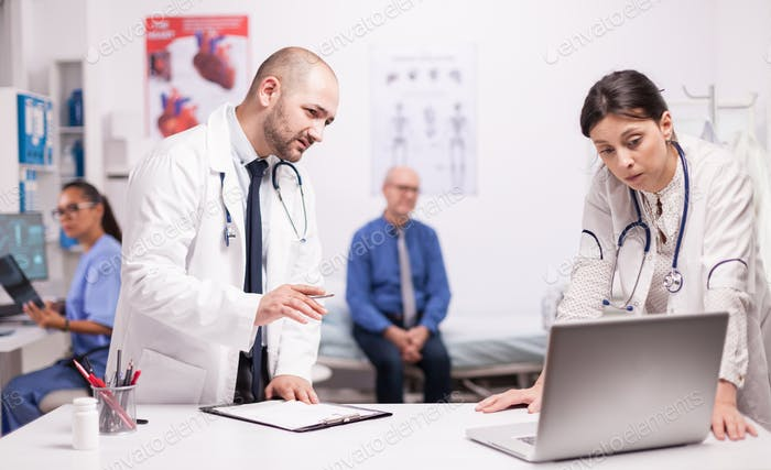 Worried doctor checking senior patient diagnosis