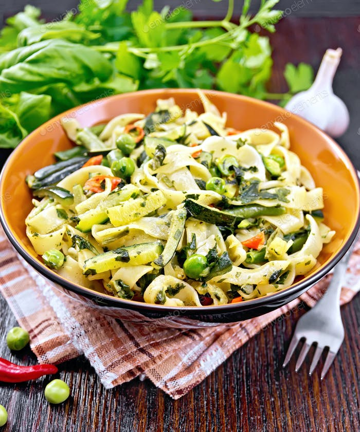 Tagliatelle with green vegetables on towel